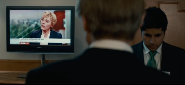 The back of Bill Nighy's head, with a TV screen in the background